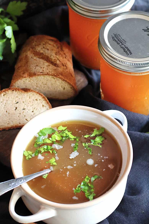Keto Bone Broth Instant Pot Recipe served in a bowl with keto farmer bread