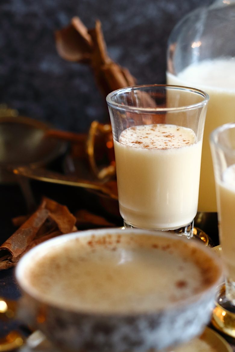 Homemade Almond Milk Keto Eggnog Recipe in small glasses with cinnamon sprinkled around