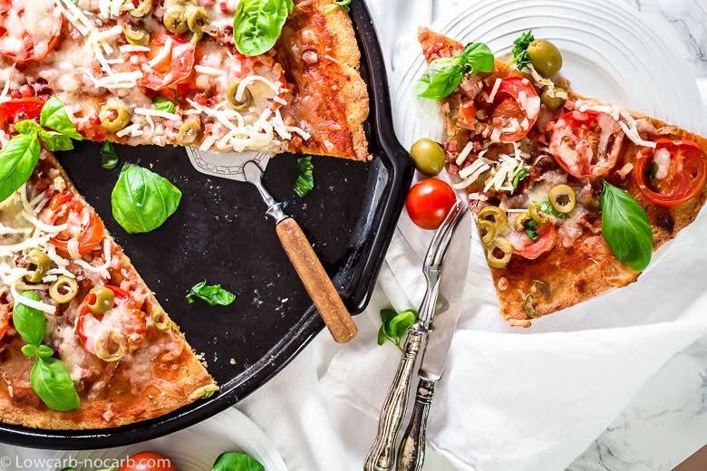 Keto Bacon Fathead Pizza Dough Recipe triangle precut on the plate