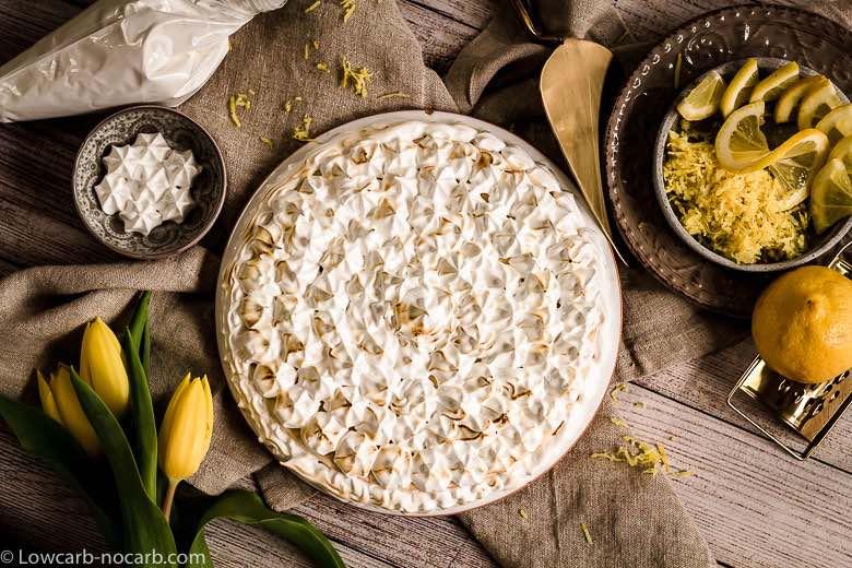 Keto Instant Pot Lemon Cheesecake with Sugar-Free Swiss Meringue Icing