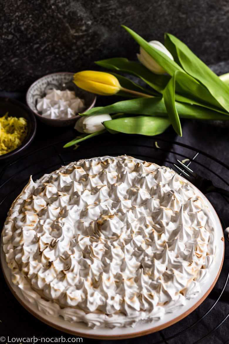 Keto Instant Pot Lemon Cheesecake with Sugar-Free Swiss Meringue Icing with yellow tulips
