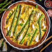 Asparagus Quiche with camembert in a white casserole dish