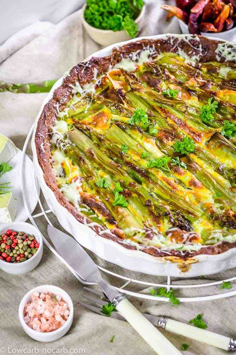 Easy Asparagus Keto Quiche baked inside a white casserole