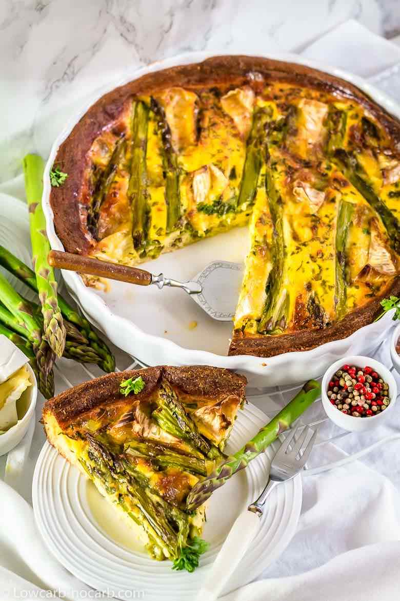 Easy Asparagus Keto Quiche slice cup on a white plate and in white casserole