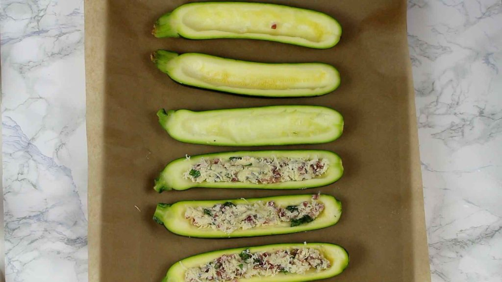 half Keto Bacon Zucchini Boats filled with cheese