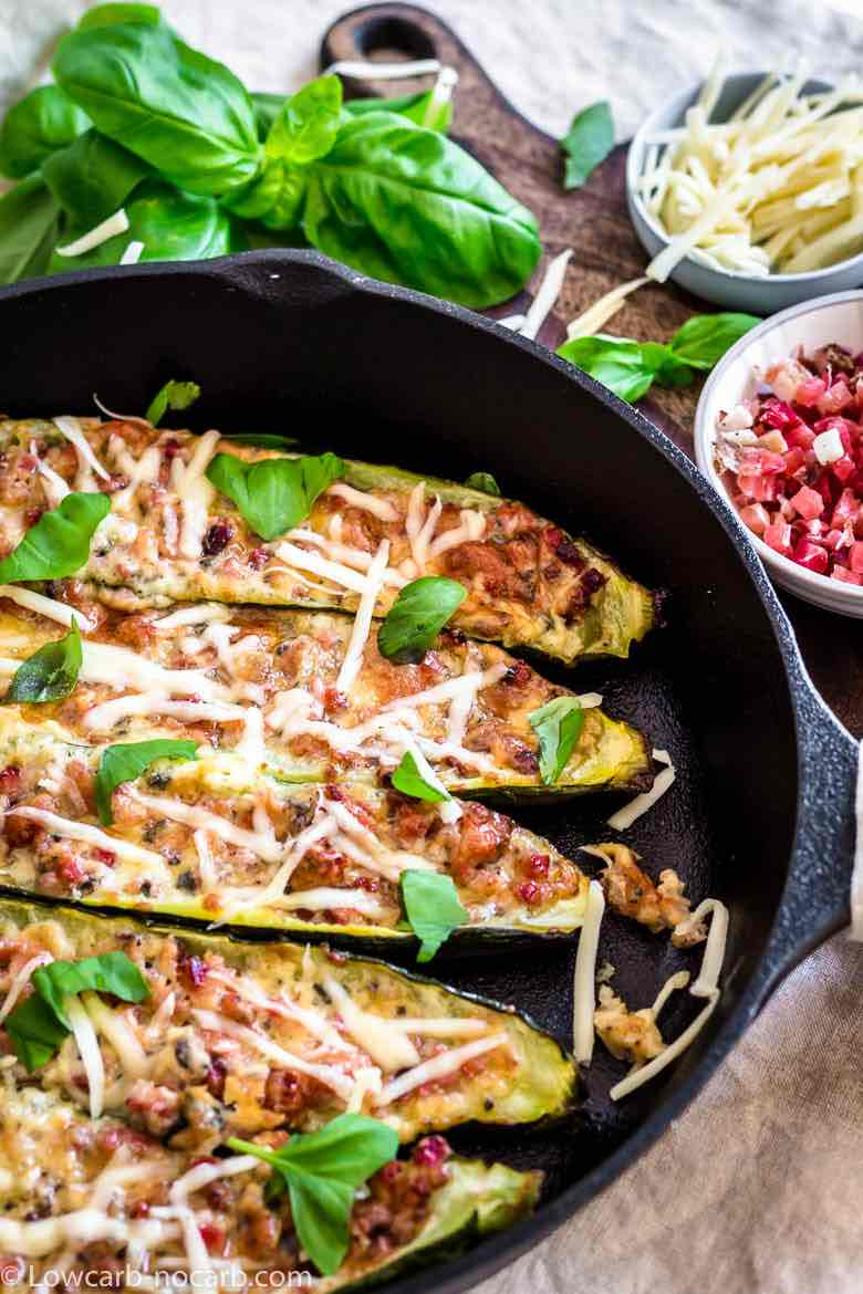 Keto Bacon Zucchini Boats placed inside the cast iron