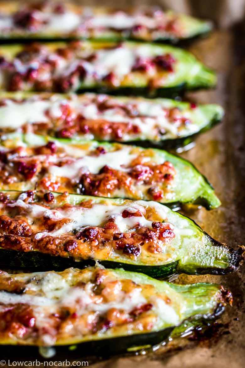 Keto Bacon Zucchini Boats with melting cheese and bacon