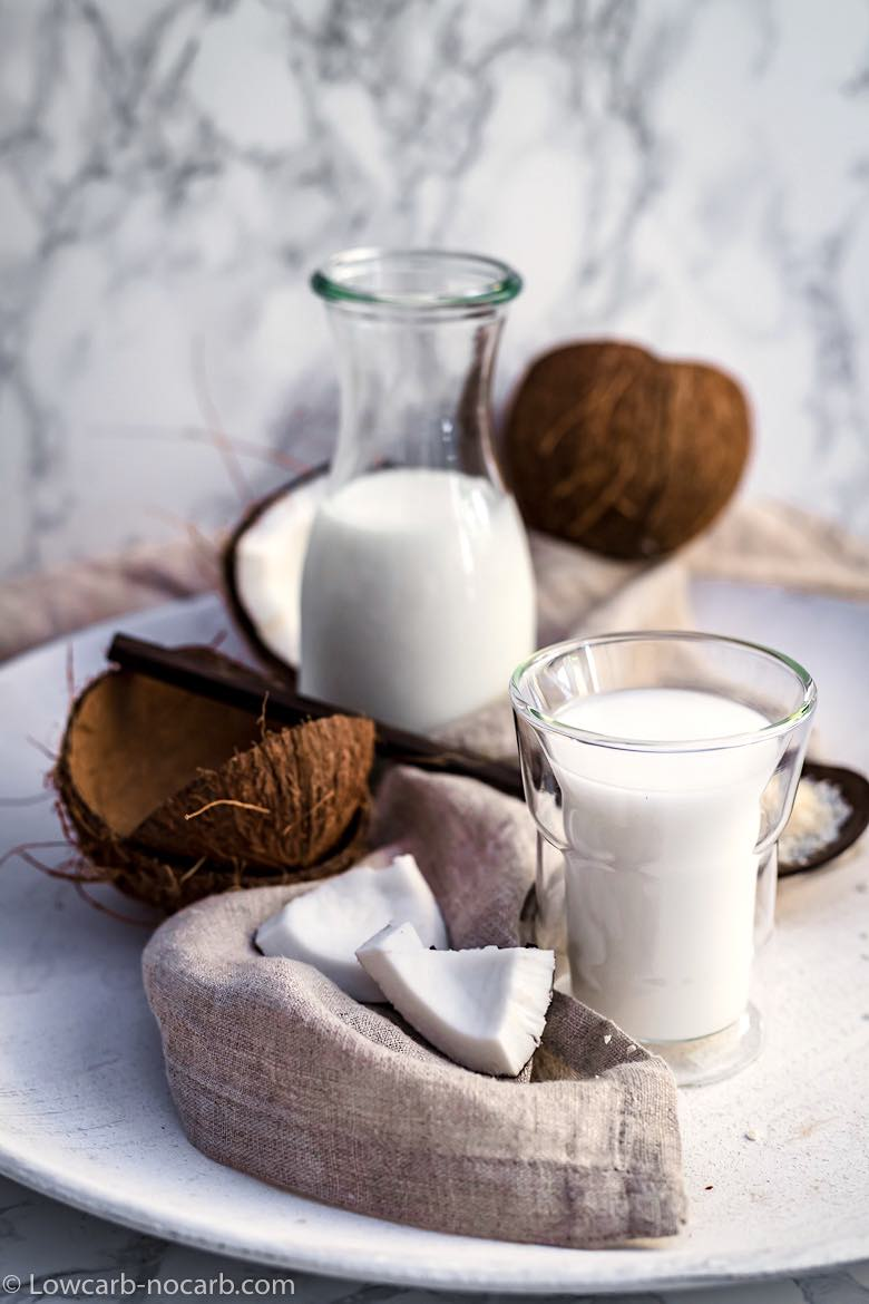 Coconut milk with shells and coconut meat
