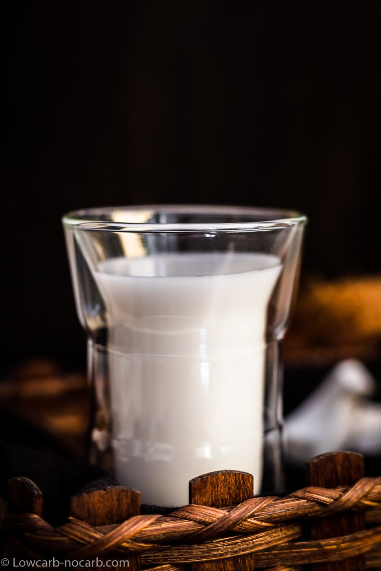 Coconut milk in a glass inside basket