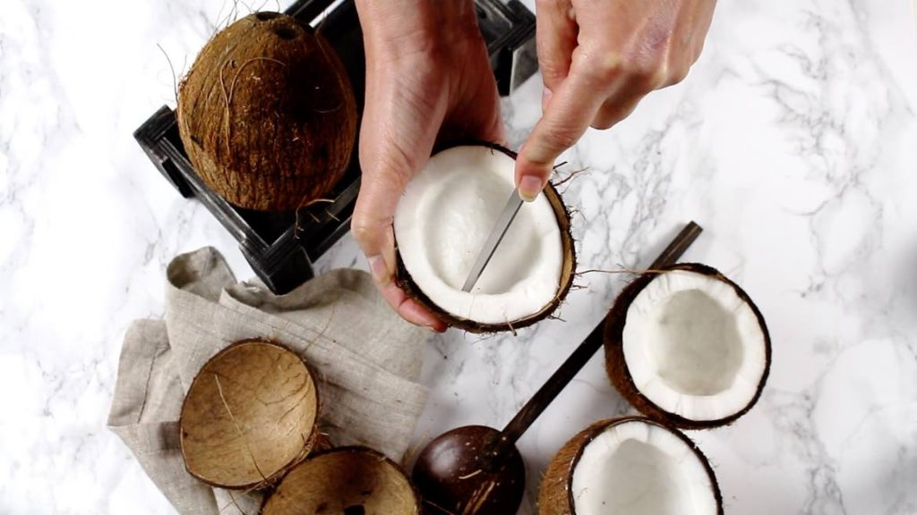 Cutting the coconut meat with a knife