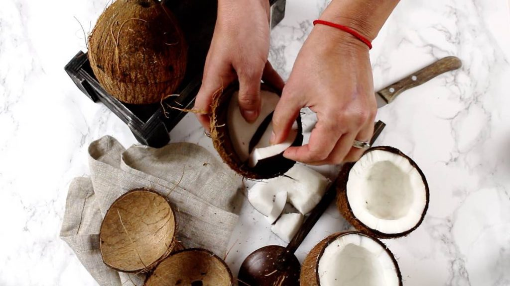 Removing coconut meat out of coconut shells