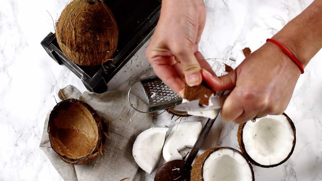 Cleaning outer layer of coconut meat