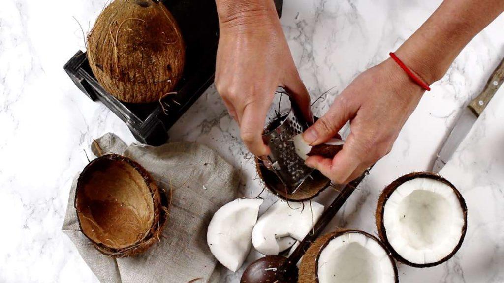Shredding coconut pieces