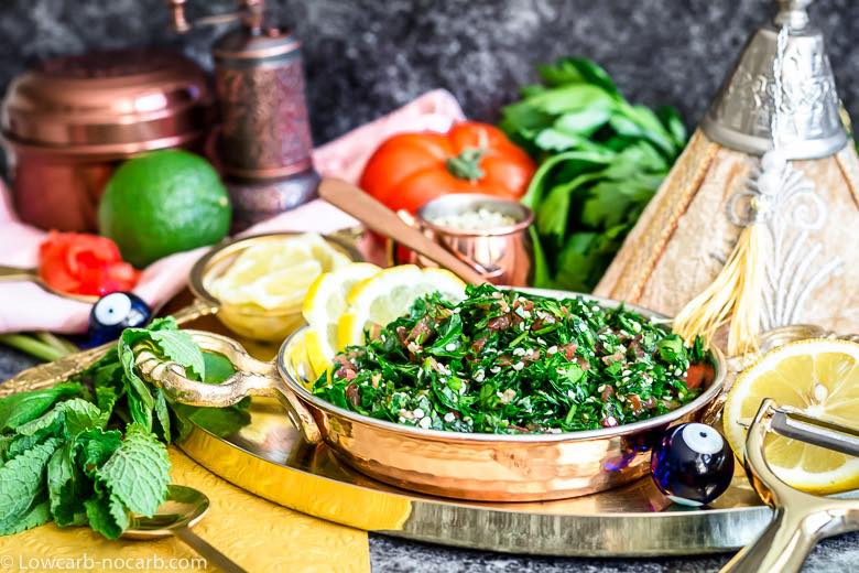 Keto tabbouleh salad with lemon and arabic decoration