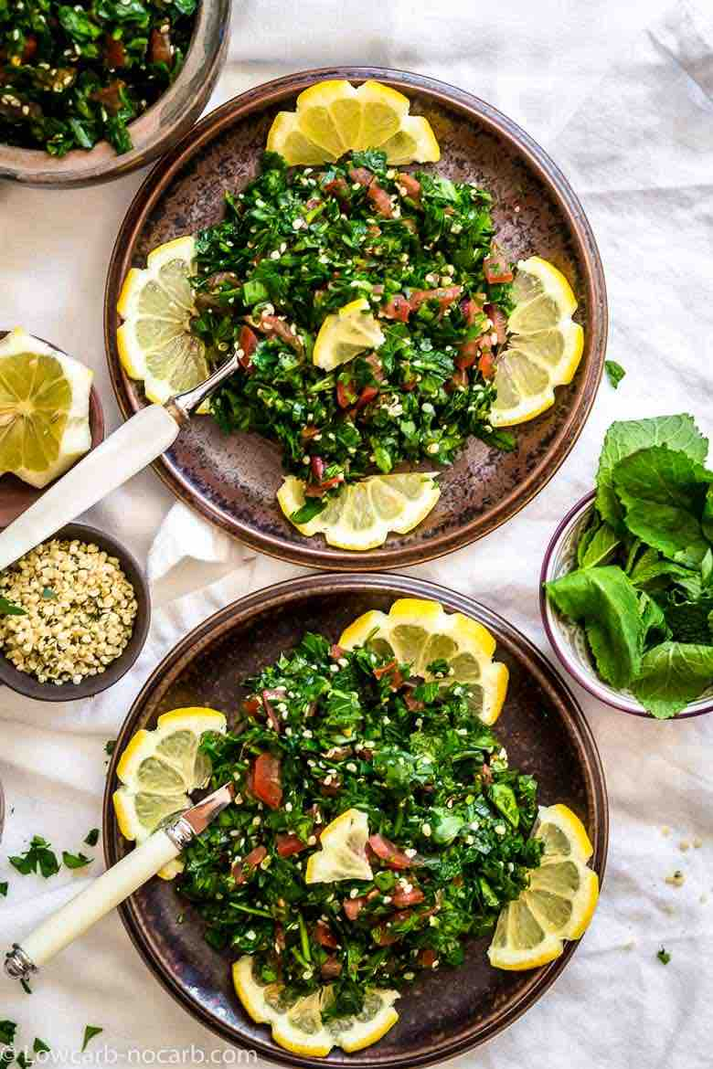 Keto Tabbouleh salad served on a dark brown plates