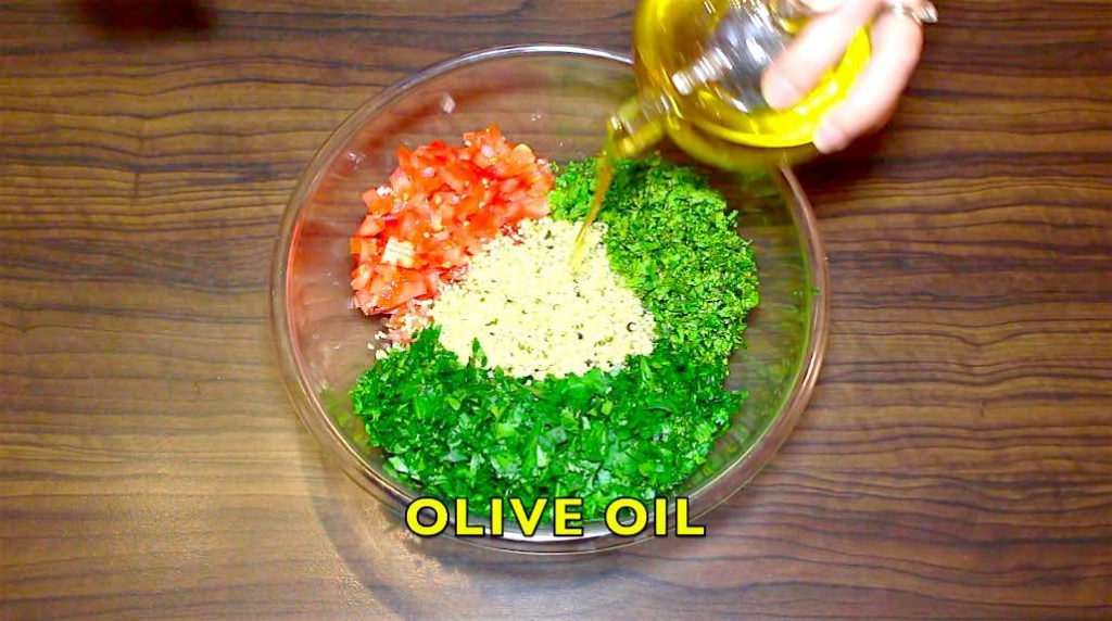 adding olive oil to the low carb salad