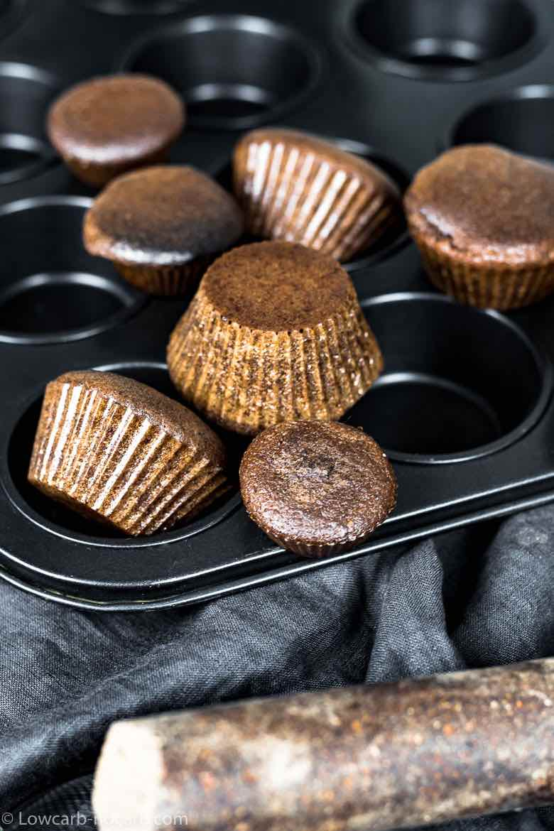 Chocolate Keto Cupcakes spread around baking muffin tint