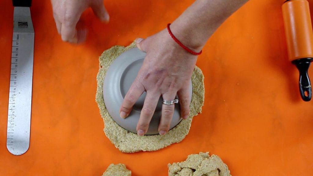 cutting keto wraps with bowl