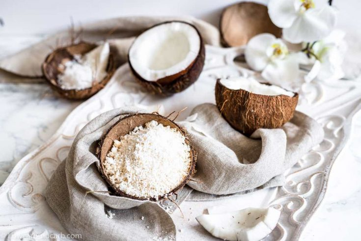 Shredded Coconut inside a coconut bowl and on a tray