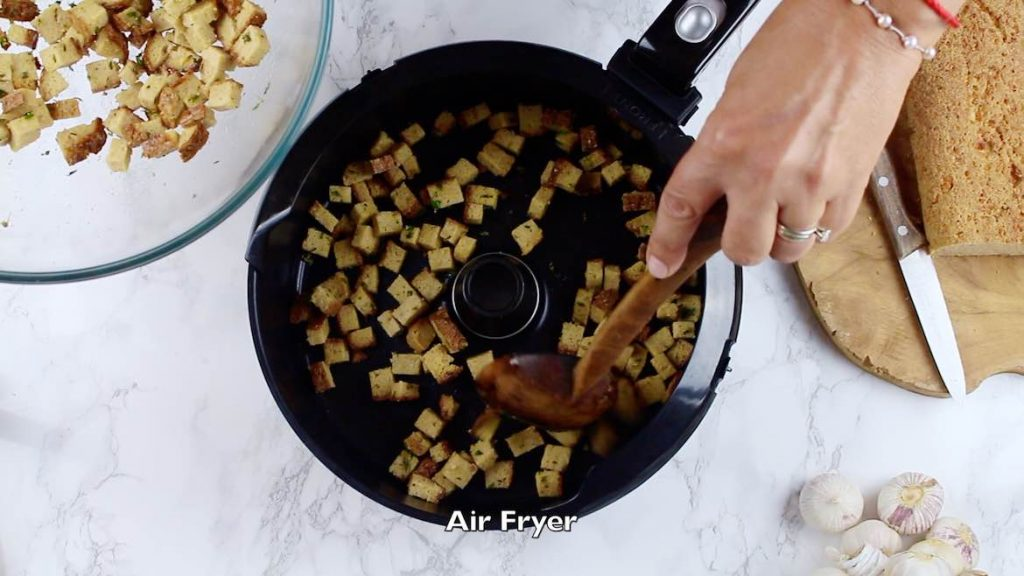 Spreading keto croutons in an Air Fryer