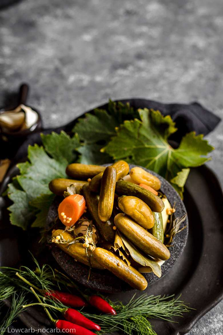 Fermented Pickles in a black serving bowl