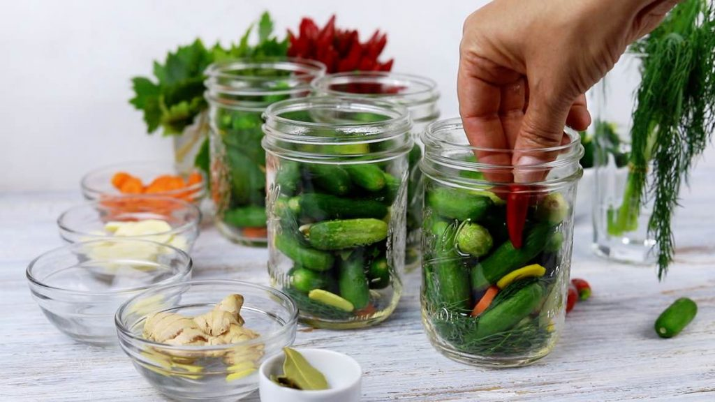 adding chilli pepper inside the pickled jar