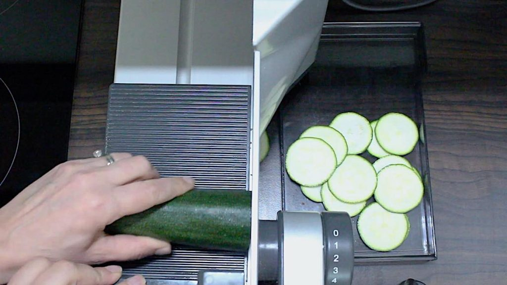 slicing zucchinis on a meat slicer maschine