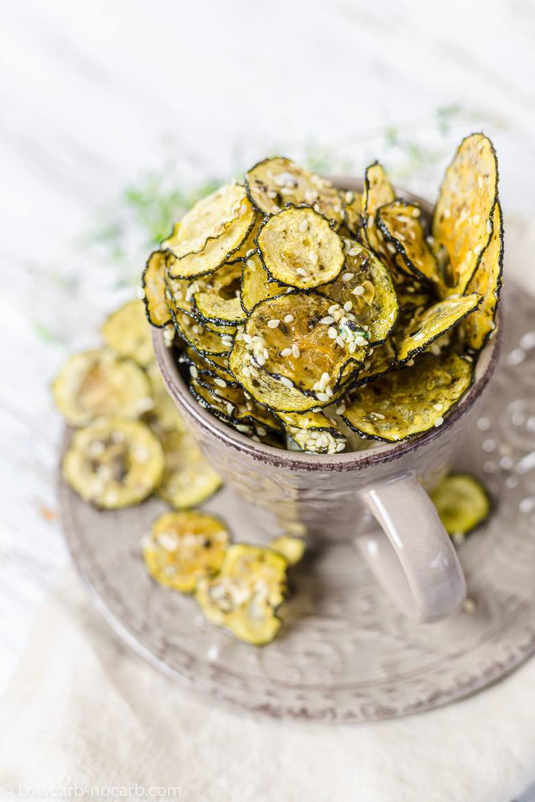sesame seeds spread on a zucchini chips