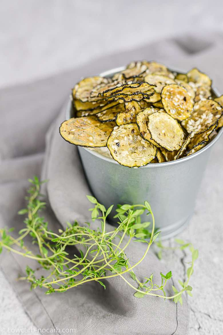 wuick zucchini chips in a metal jar