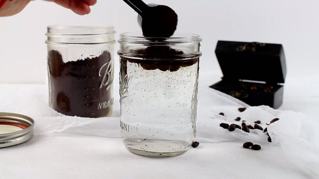 adding ground coffee to make Cold Brew Keto Coffee