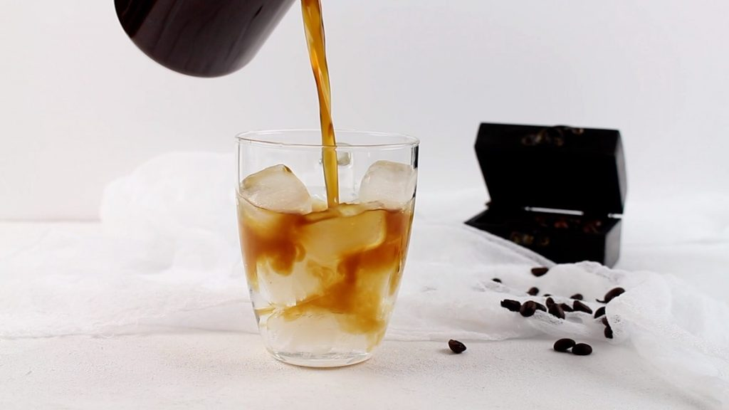 Pouring concentrated Coffee over ice