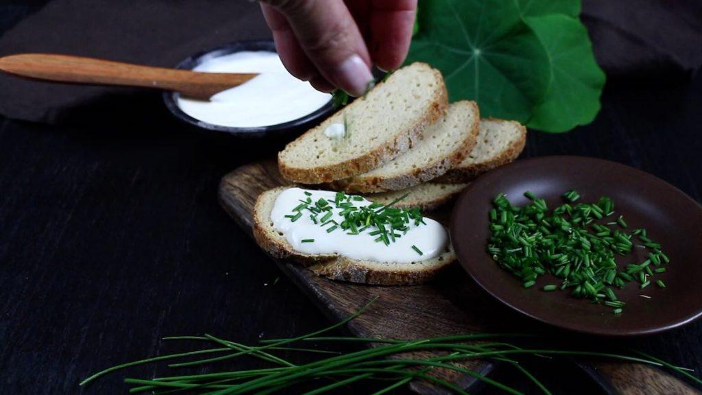 Spreading Fresh Cream on a Keto Farmers Bread