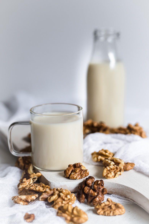 walnuts milk in a glass and jar