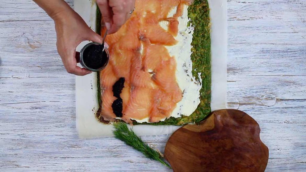 Filling caviar onto a smoked salmon Low Carb Roulade