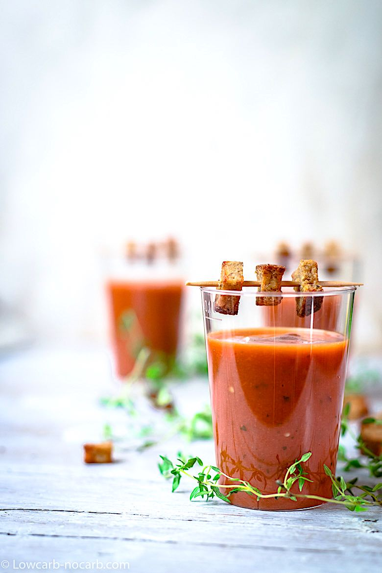 party serving Gazpacho looking tomato basil soup