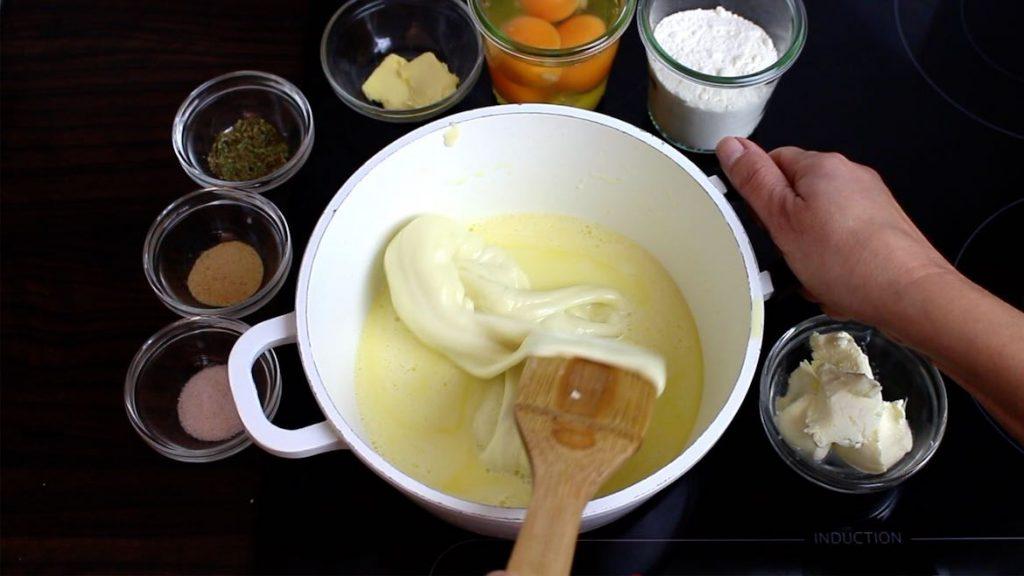 melting mozzarella in a pot