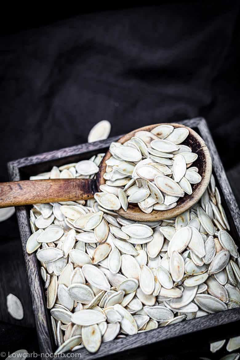 Box of a Pumpkin Seeds with a wooden spoon