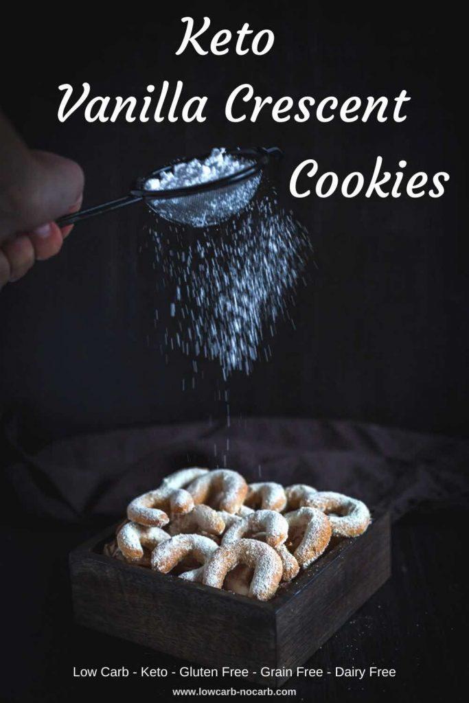 Sprinkling sugar on Keto Vanilla Crescent Cookies
