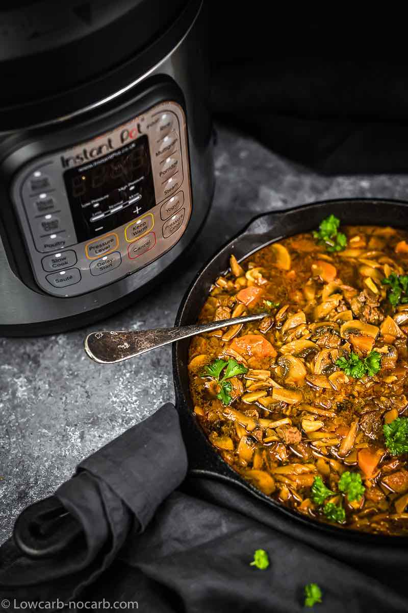 Goulash served in a dish with Instant Pot in the background