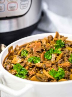 Beef Stew Goulash in a white casserole with Instant Pot in the background