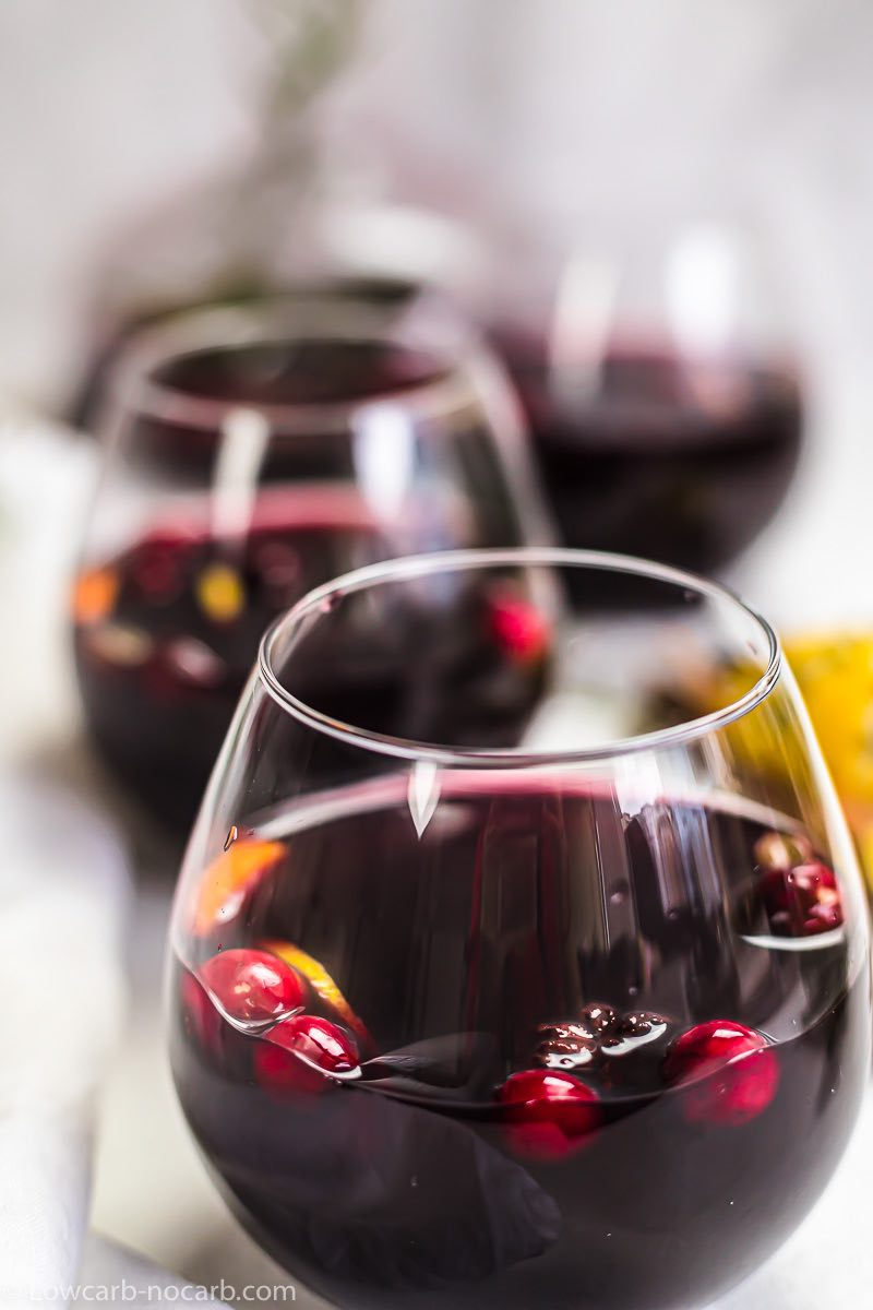 a glass of cranberry keto mulled wine