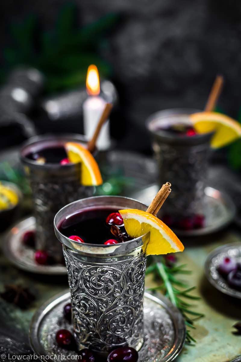 cinamon stick inside mulled wine silver glass
