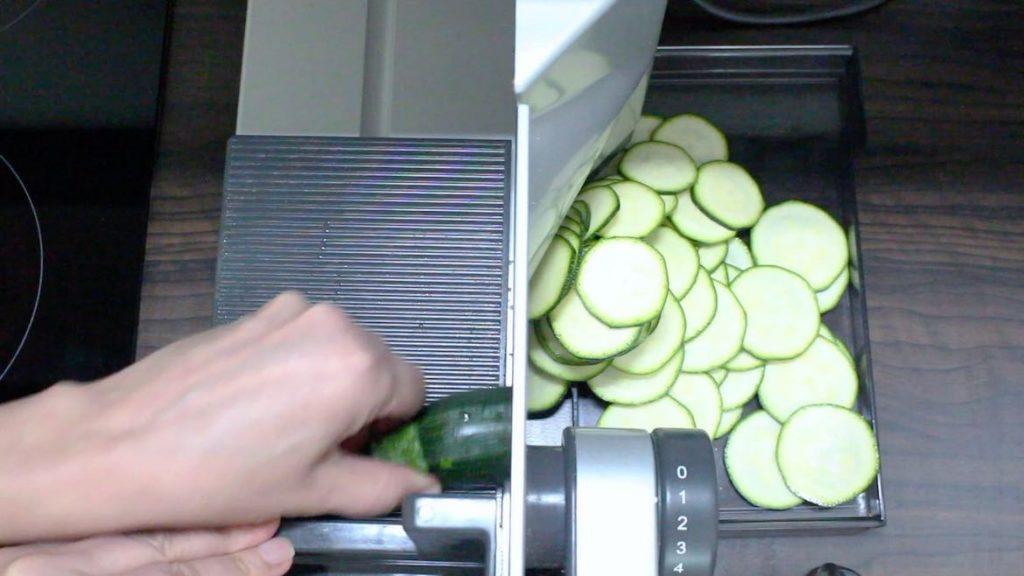 cutting zucchini into chips