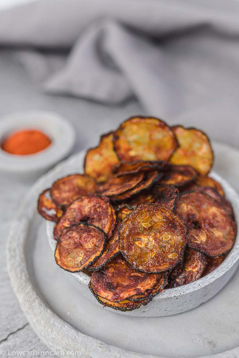 baked zucchini chips inside a grey plate