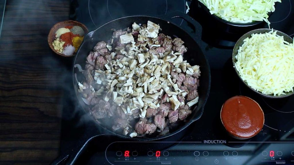 Cheesy Cabbage Beef Keto Casserole mushrooms being added into the skillet
