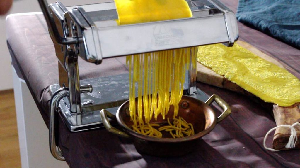 Keto Noodles being cut with a pasta machine
