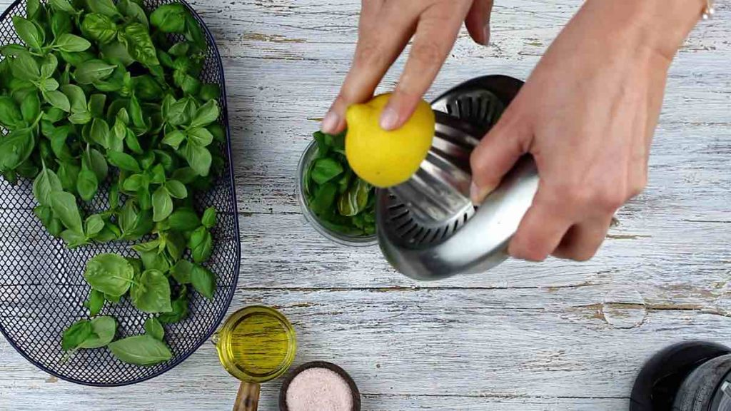 Basil Pesto Without Nuts pouring lemon juice in
