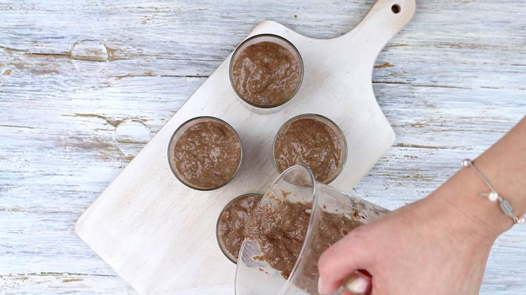 Chocolate Chia Pudding pouring into the glass