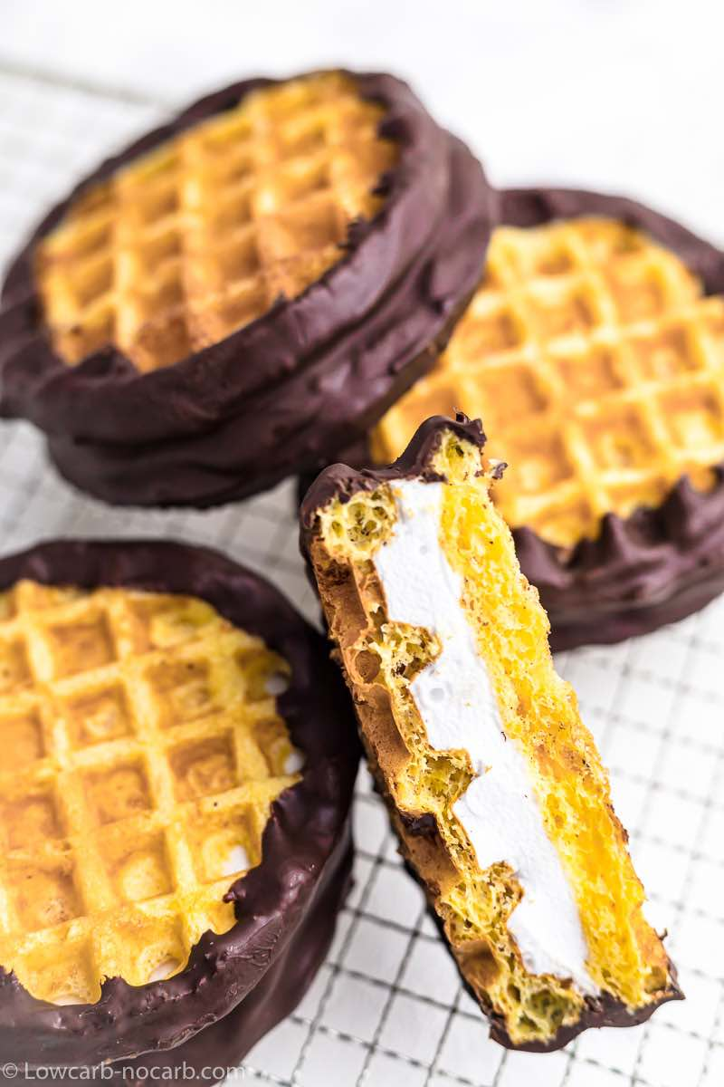 keto desserts chaffles with chocolate coating on a metal stand