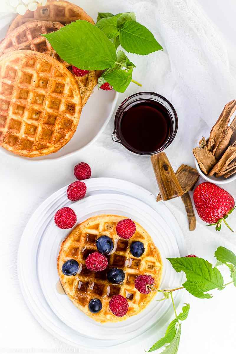 Chaffle Sweet Recipe with berries and cinnamon on a white plate